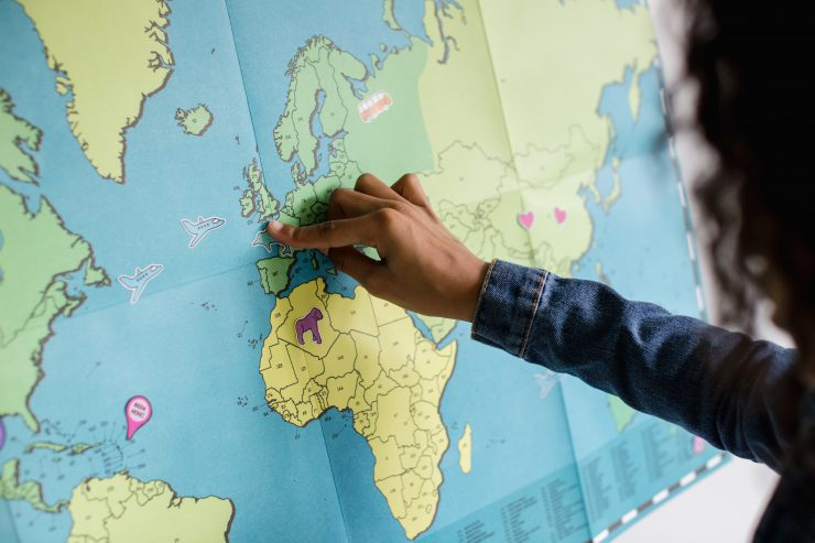 A hand pointing on the map
