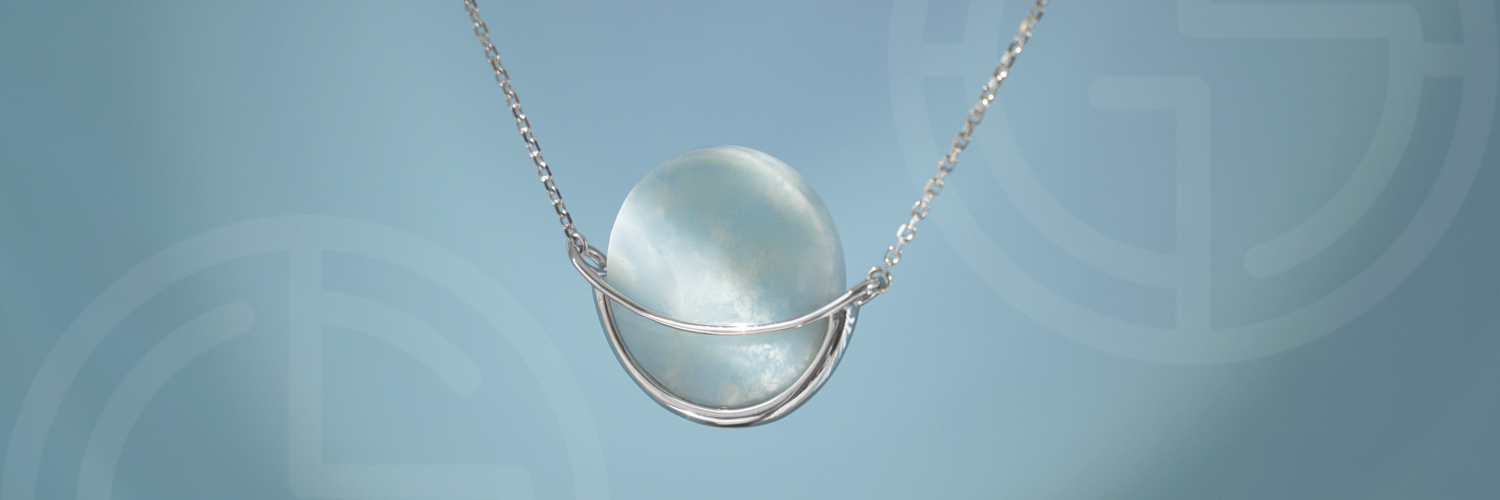 Natural semi-precious gemstone geometric minimalist jewellery by Gems In Style, Dancing Orbit pendant with Larimar.