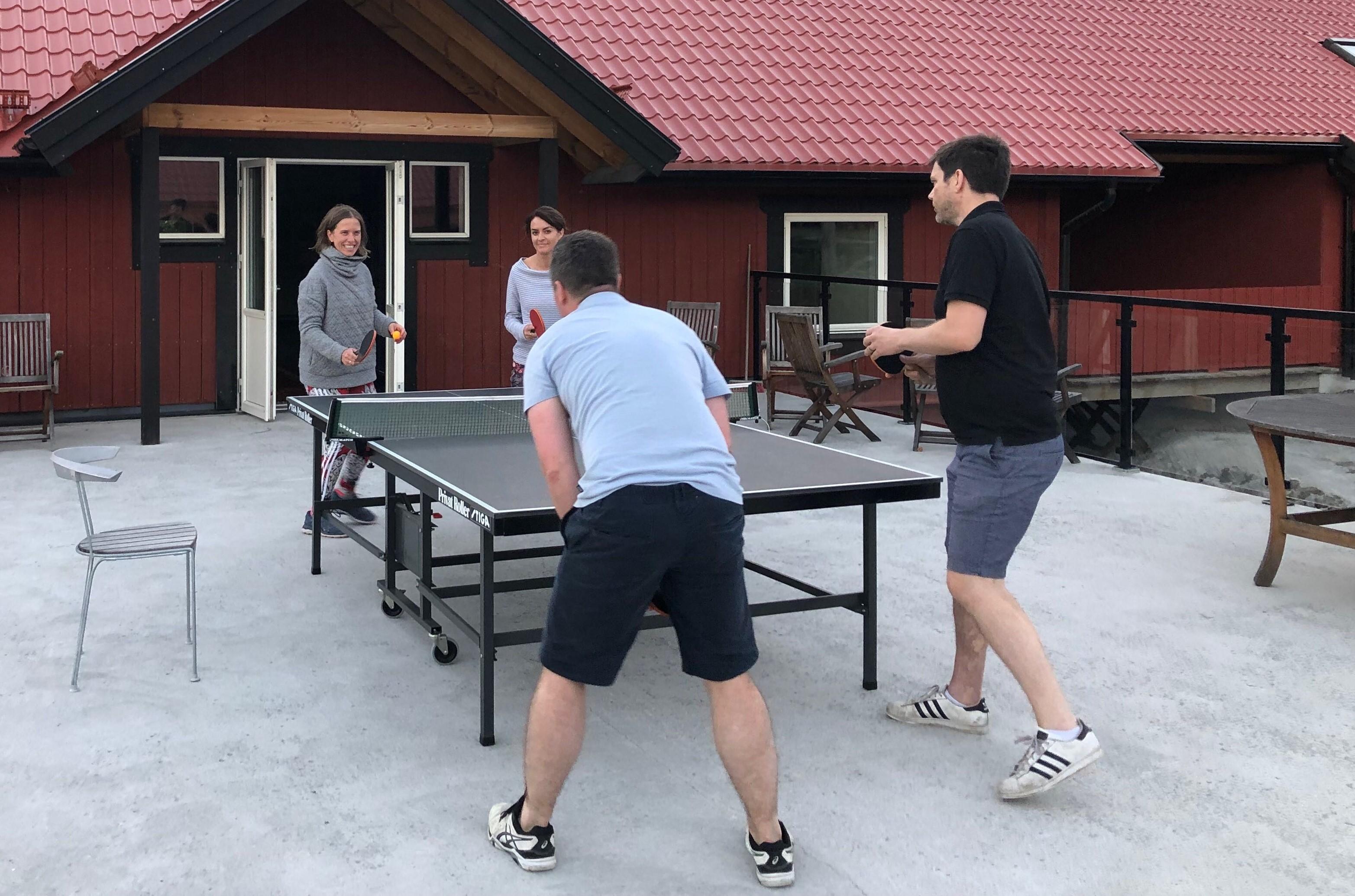 Playing ping pong.